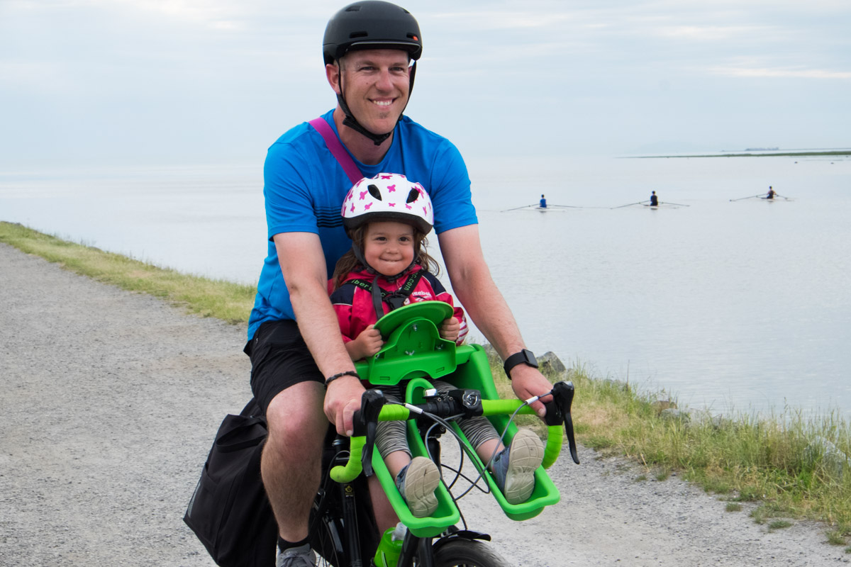 Cyclist Commutes with Daughter in Front Seat of Bike