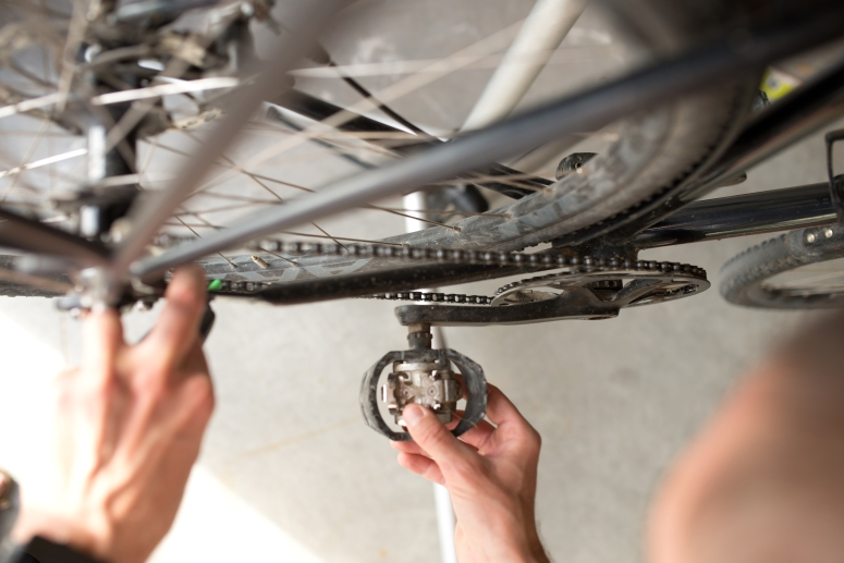 Bike commuter applying chain lube