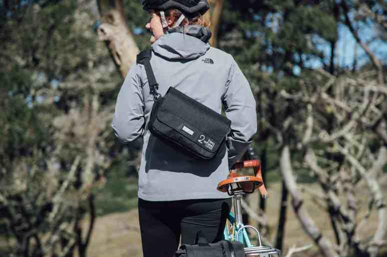 Two Wheel Gear - Mini Messenger Handlebar Bag - On Back of Woman commuting in San Francisco