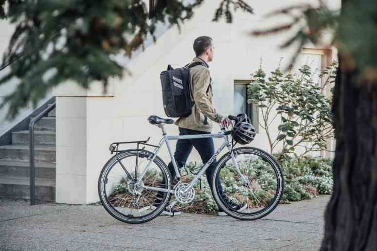 Two Wheel Gear - Pannier Backpack Convertible PLUS+ in Black on bike commuter's back