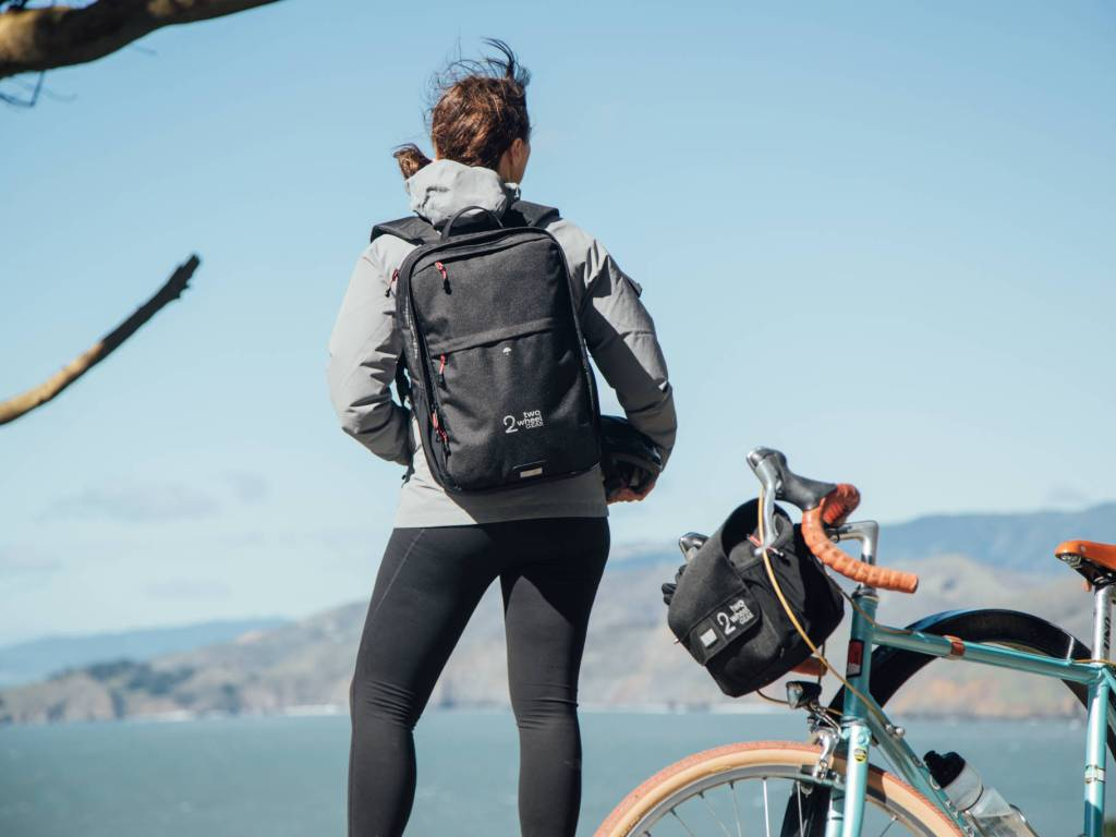 Two Wheel Gear - Pannier Backpack PLUS+ and Mini Messenger Handlebar Bag on Woman in San Francisco